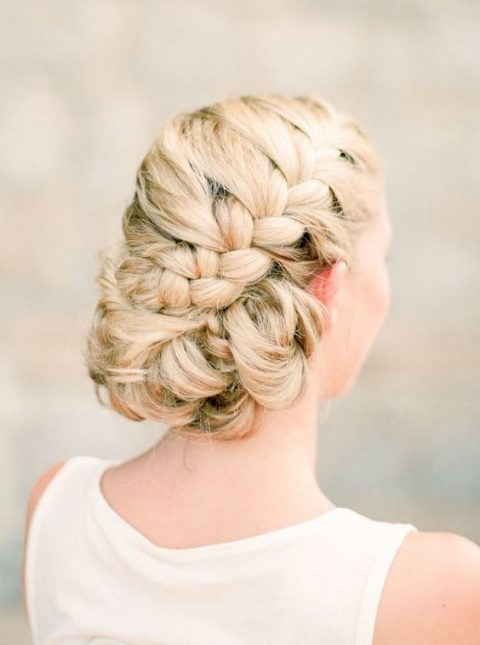 large side braided updo with twisted sides
