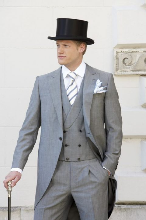 light grey morning suit with a striped tie and a top hat