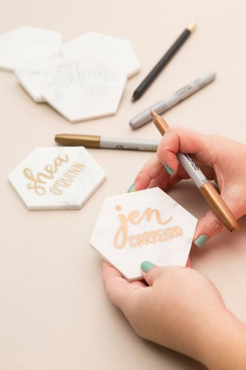 marble hexagon place cards with copper calligraphy