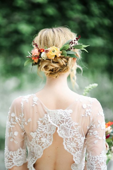 messy twisted updo with bold fall blooms and foliage
