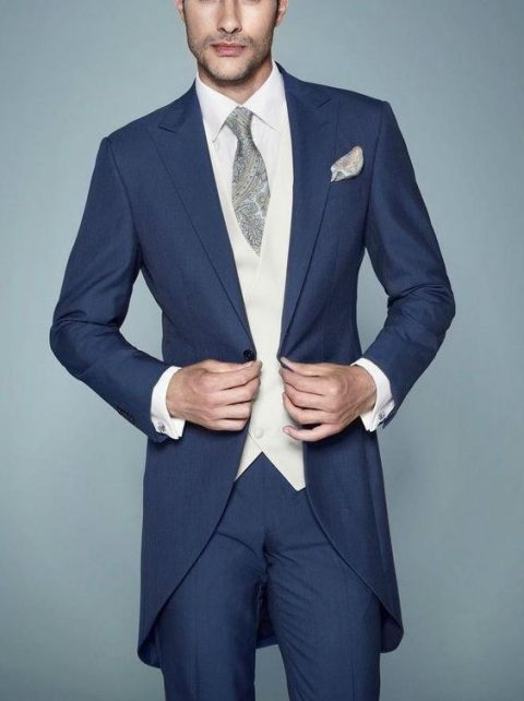 navy morning suit with a white vest and a printed dove grey tie