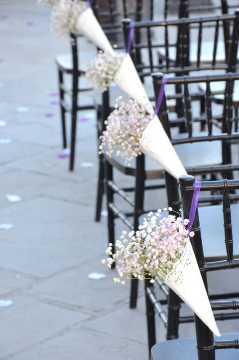 paper cones with baby's breath for aisle decor