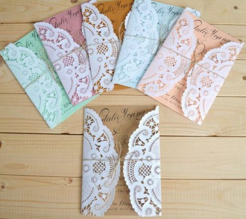 paper doilies as wedding invitation envelopes