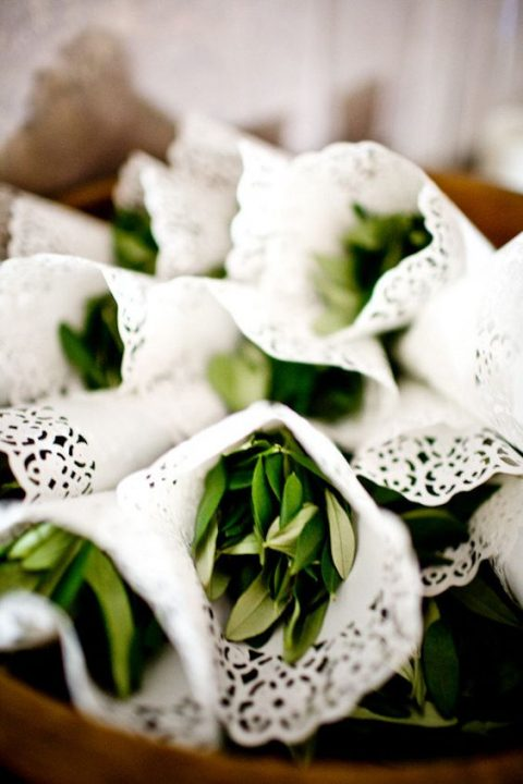 paper doilies with olive leaves for wedding exit