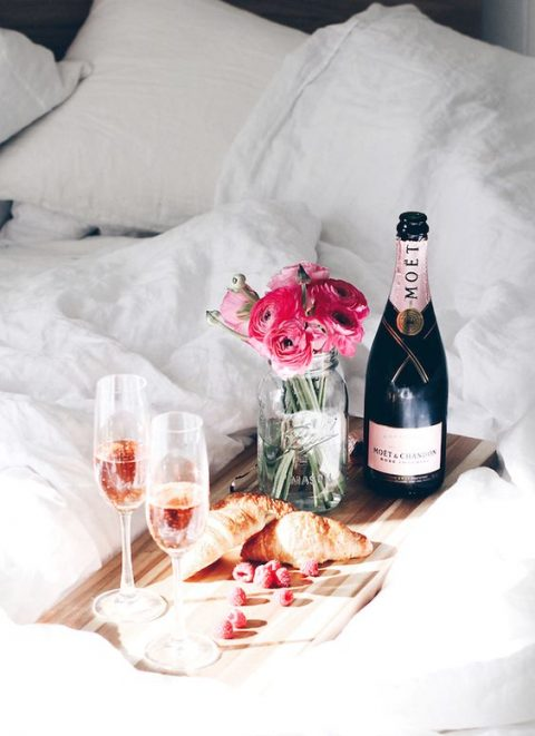 romantic breakfast just for two - croissants and pink champagne
