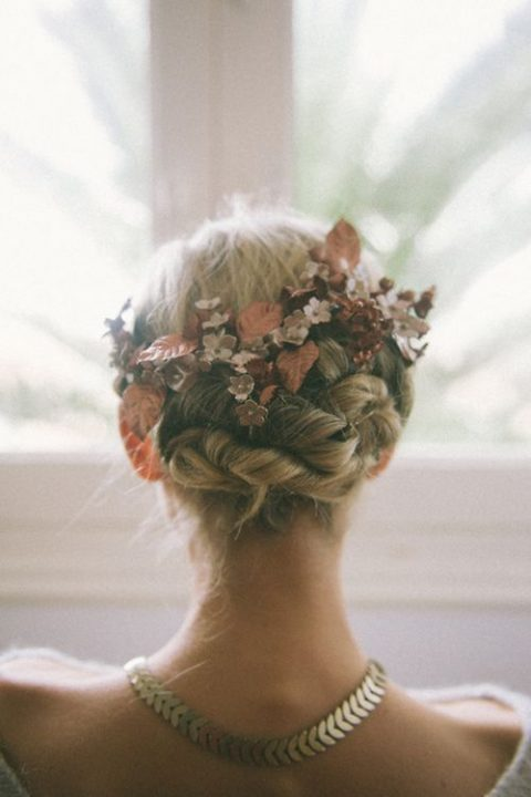 twisted updo with faux leaves and flowers