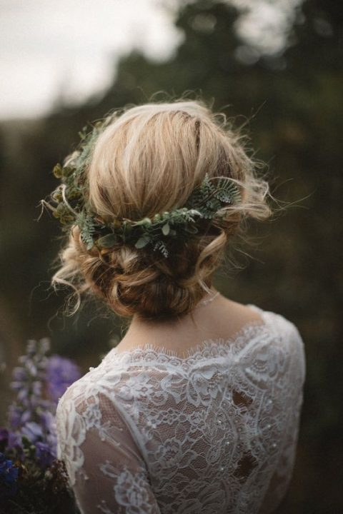 twisted wedding updo with fern and foliage