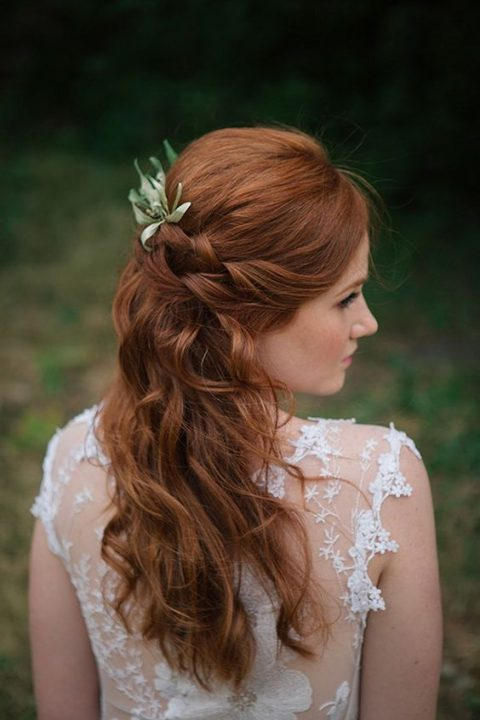 wavy and twisted half updo with foliage