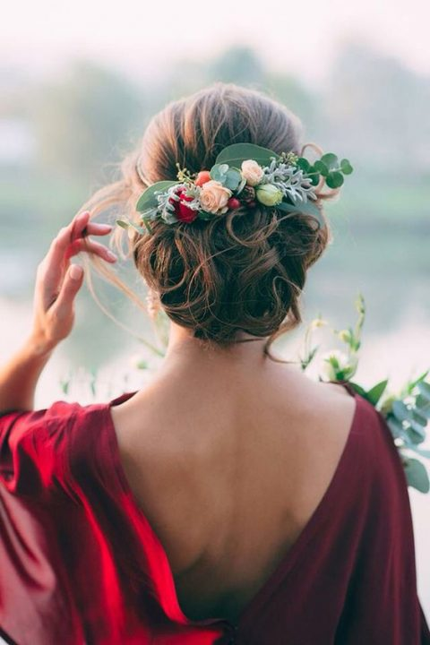 wavy updo with fresh blooms and leaves