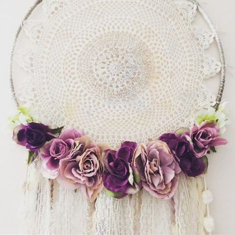 wedding dream catcher with a large doily and fabric flowers