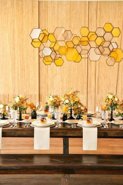 yellow and white hex glass pendant decoration over the table