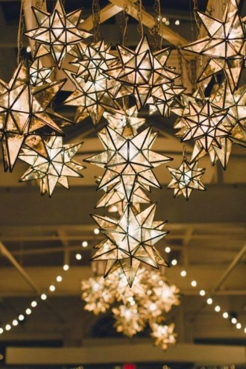 3D star decorations and lamps in one hanging over the reception