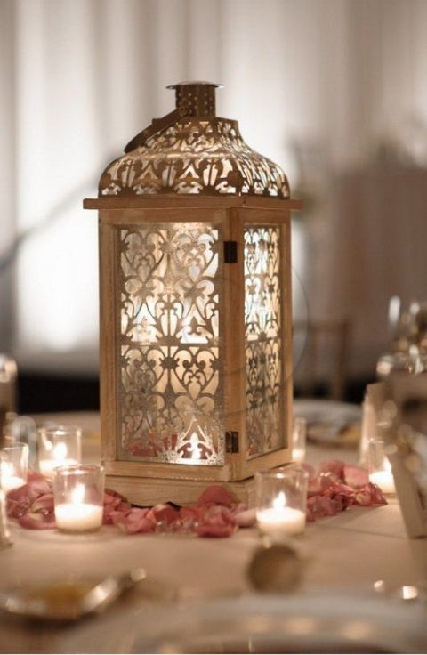 a Moroccan-style candle lantern surrounded with flower petals and candles