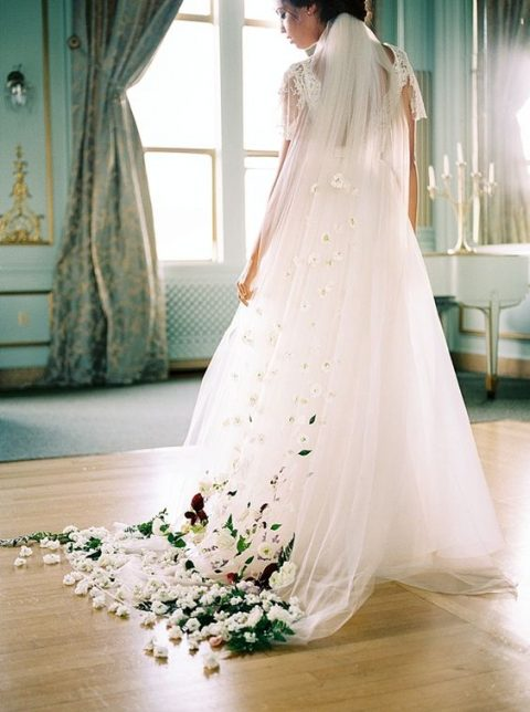 a colorful floral wedding veil by Sarah Seven