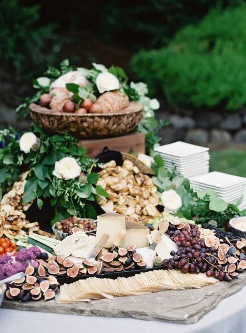 a fall cheese station with figs, grapes, cheese and crackers