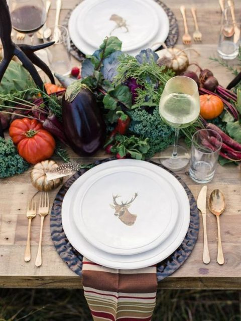 a harvest table runner with peppers, pumpkins, tomatoes, eggplants and broccoli