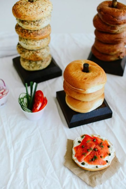 a modern bagel bar with veggies and cream cheese
