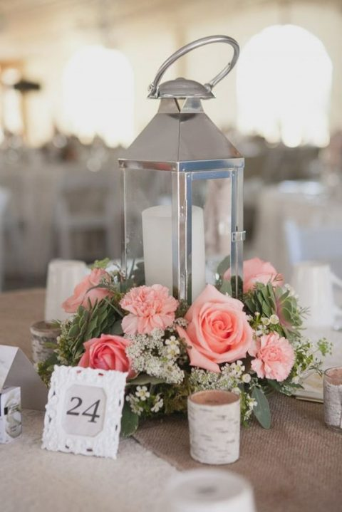 a modern candle lantern with succulents, white and pink blooms