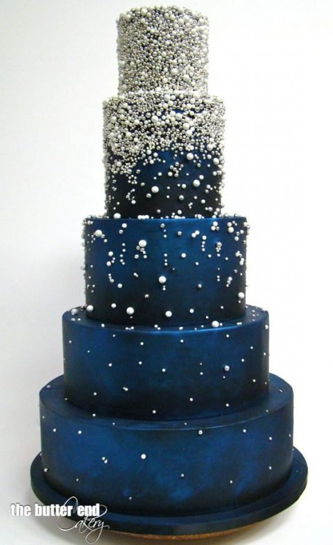 a navy wedding cake topped with silver and white beads for a starry night wedding
