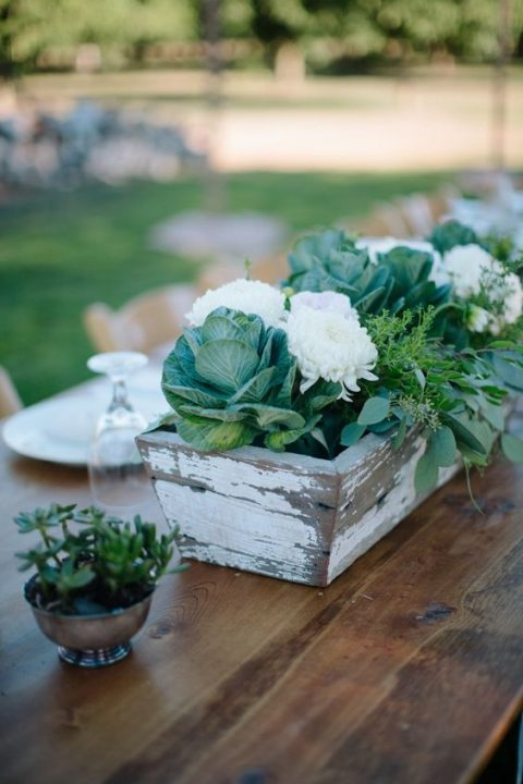 a shabby chic box with white blooms and cabbage for a rustic wedding