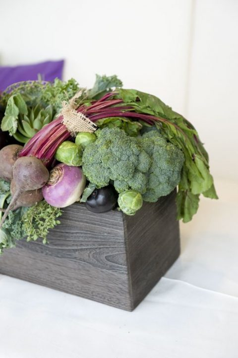 a wooden box with cabbage, radish, beets, broccoli and other vegetables
