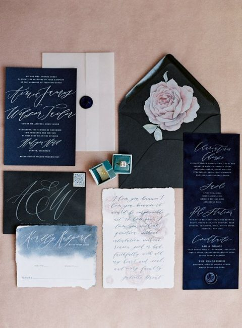 black and navy wedding stationary with white calligraphy