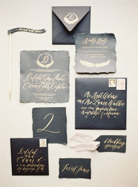 black stationery with gold calligraphy for a glam wedding
