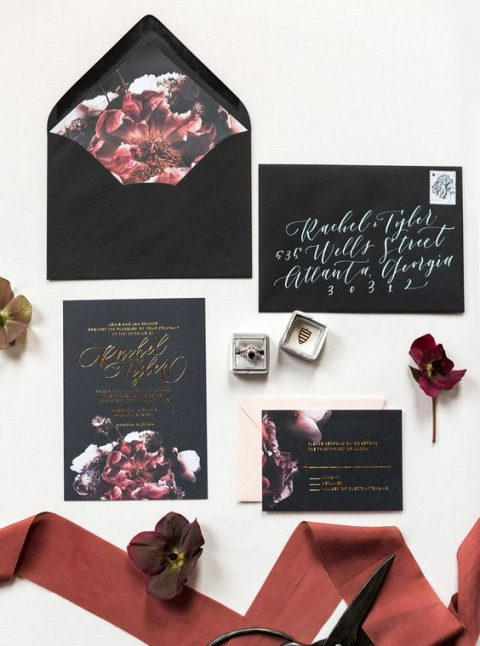 black wedding stationery with burgundy and purple realistic floral lining and gold calligraphy