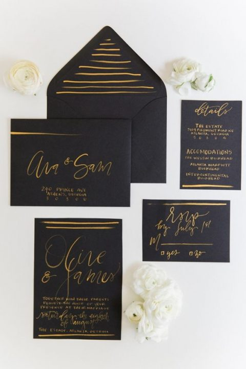 black wedidng stationary with gold calligraphy looks refined and chic