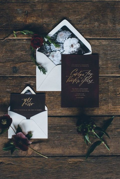 burgundy wedding invites with gold calligraphy and white envelopes with floral lining