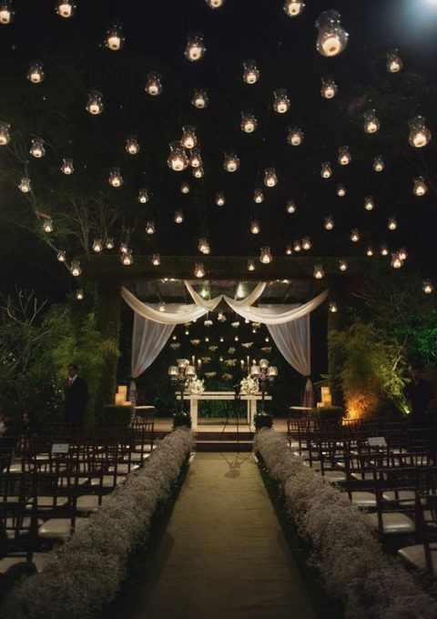 candles floating in the air for a gorgeous ceremony space