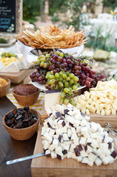 cozy rustic cheese bar with grapes, dried fruits, cheese and crackers