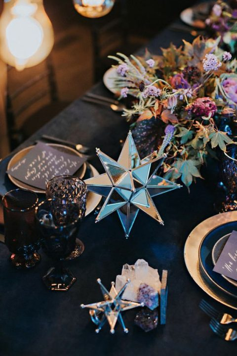 dark florals and 3D mirror star wedding decorations