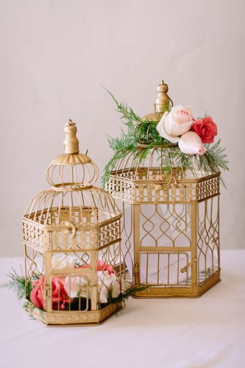 gilded bird cages with greenery and flowers