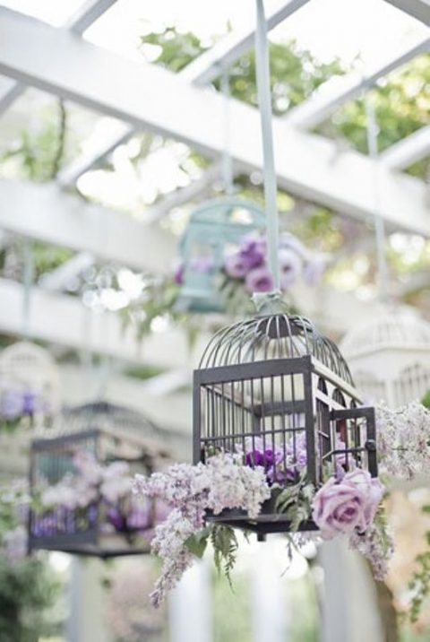 hung bird cage with florals instead of a usual table centerpiece