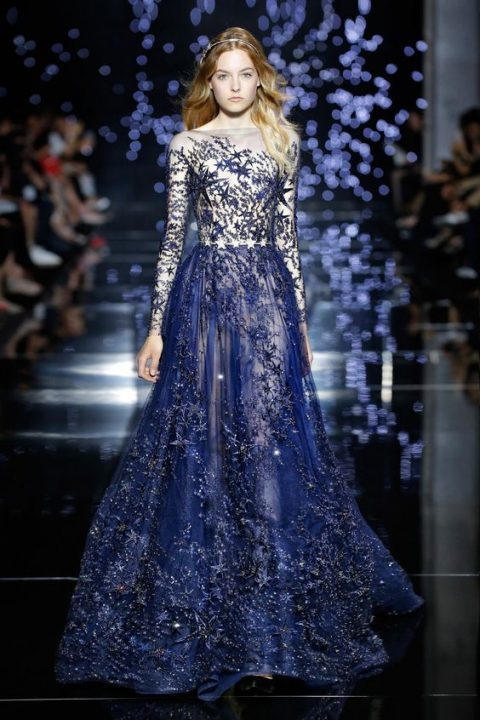 jaw-dropping starry night wedding dress with illusion sleeves, a light top and a navy skirt with lots of stars