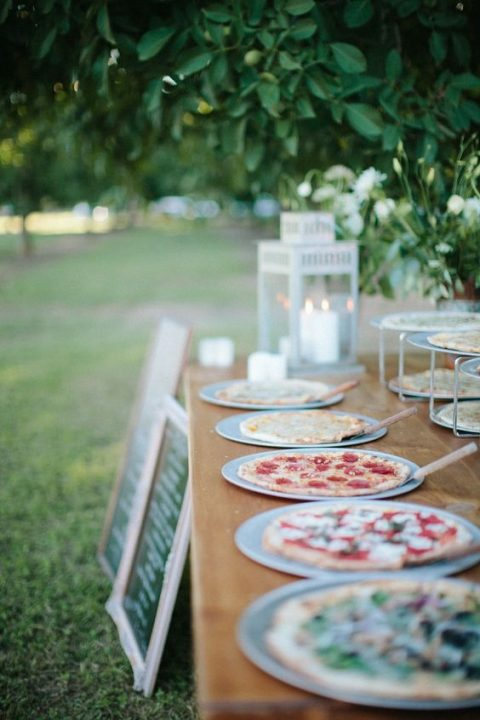 outdoor pizza bar with candle lanterns and metal stands