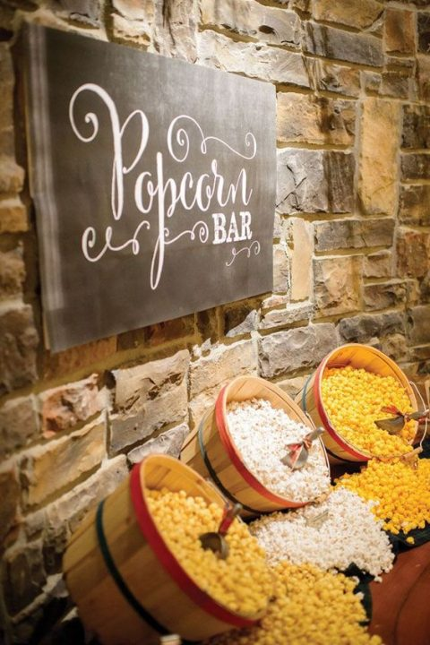 rustic popcorn bar with wooden baskets and a chalkboard sign