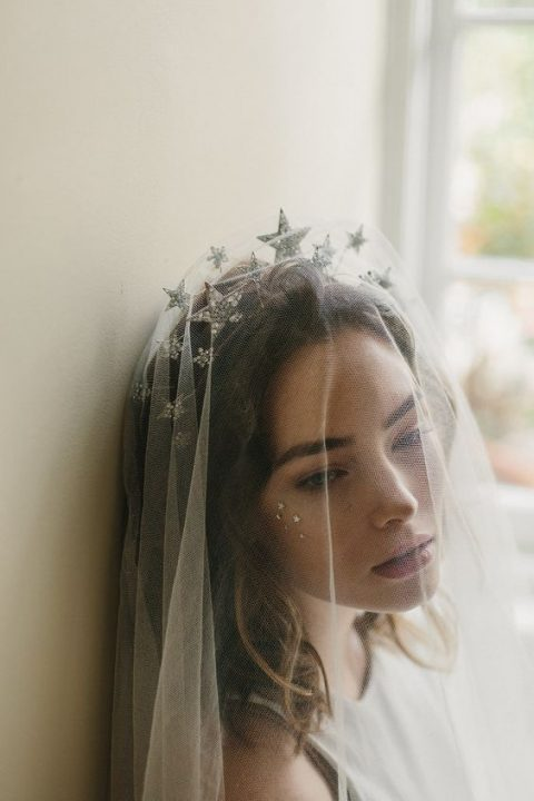 star wedding headpiece and a veil over it