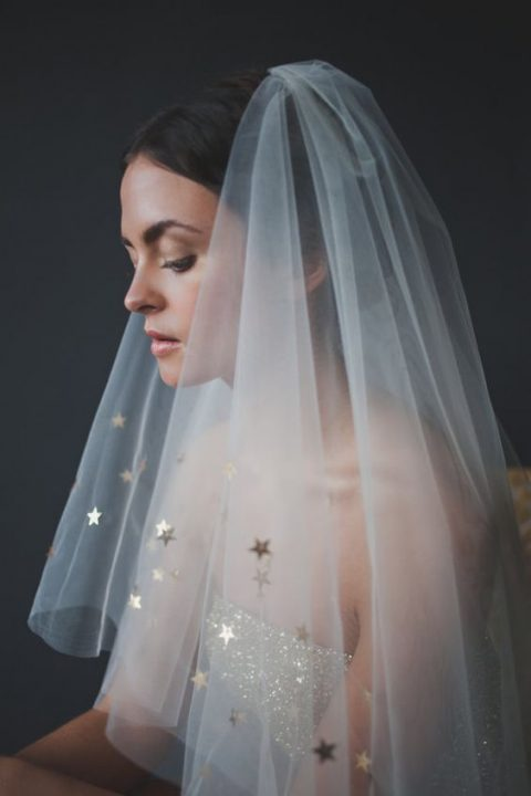 star wedding veil matches a glitter wedding dress