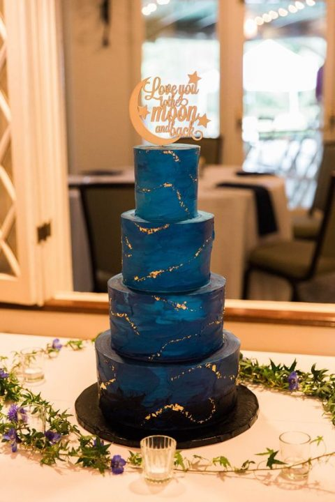 starry night wedding cake with a gorgeous topper