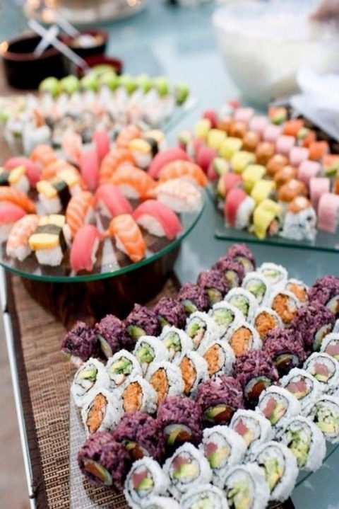 sushi and rolls served on glass stands to make them look yummier