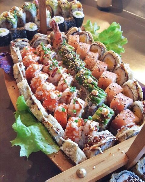 sushi served on wooden platters for a cool look