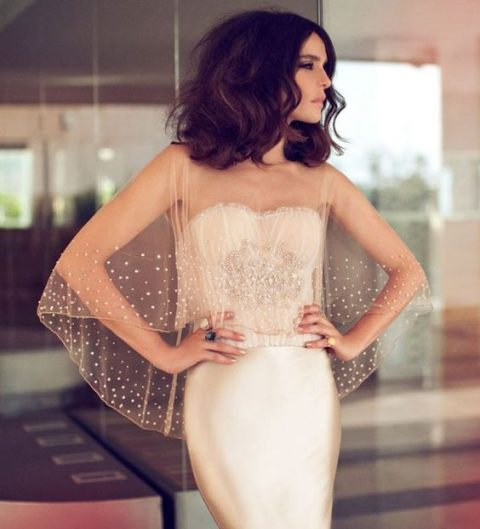 a champagne-colored sheer wedding capelet with rhinestones