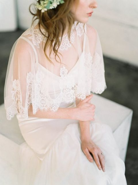 a chic lace capelet with a lace edge and neckline