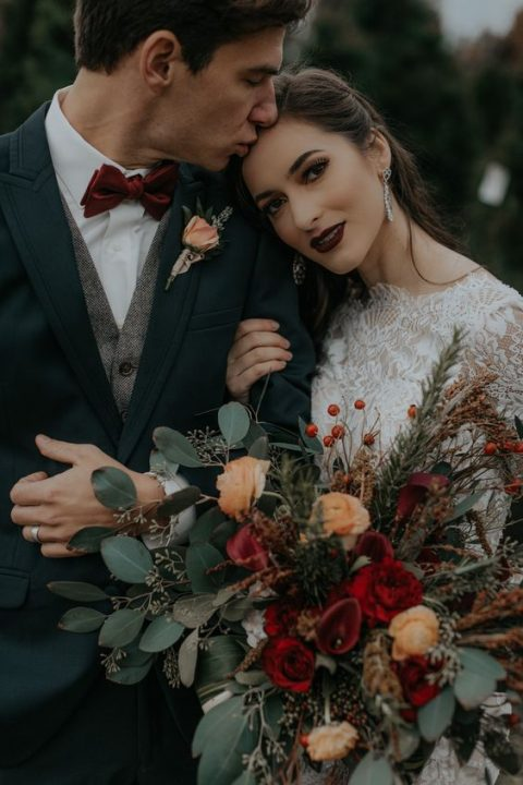 a dark lip and elegant earrings are a chic idea for a moody bride