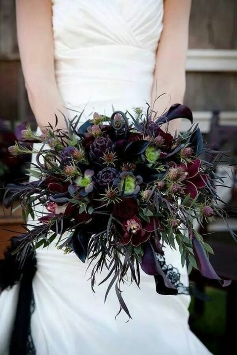 a dark succulent_ deep purple and burgundy blooms wedding bouquet
