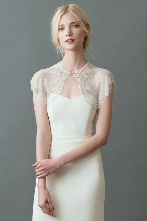 a delicate embroidered capelet with a rhinestone button