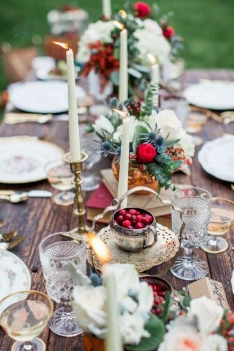 a festive wedding tablescape with gold and touches of red