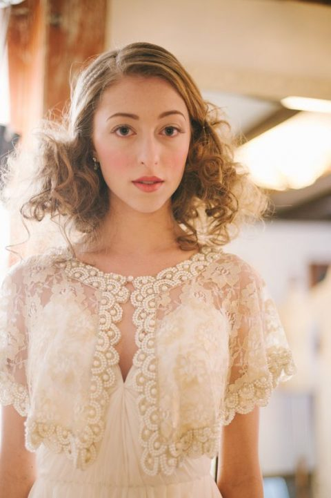 a gold lace capelet with pearls looks vintage